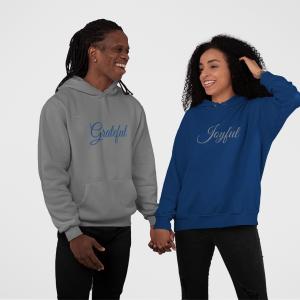 Couple wearing Joyful & Grateful hoodies by CP Designs Unlimited