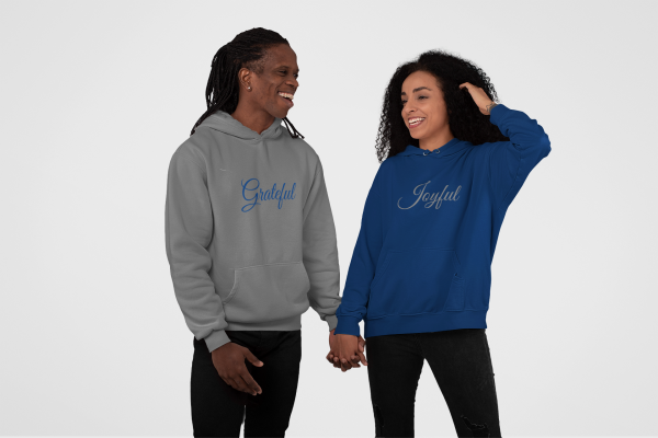 Couple wearing Joyful & Grateful hoodies by CP Designs Unlimited